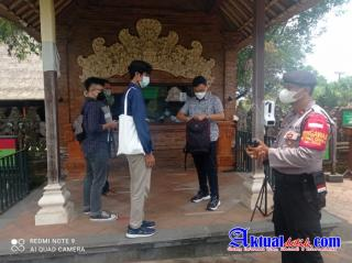 Unit Samapta Polsek Mengwi Pantau Pelaksanaan Prokes dan PPKM Level-3 di Obyek Wisata Taman Ayun